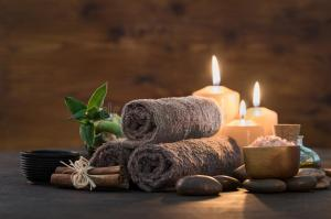 beauty-spa-treatment-candles-brown-towels-bamboo-relax-massage-body-beautiful-composition-stones-salt-wooden-101012834